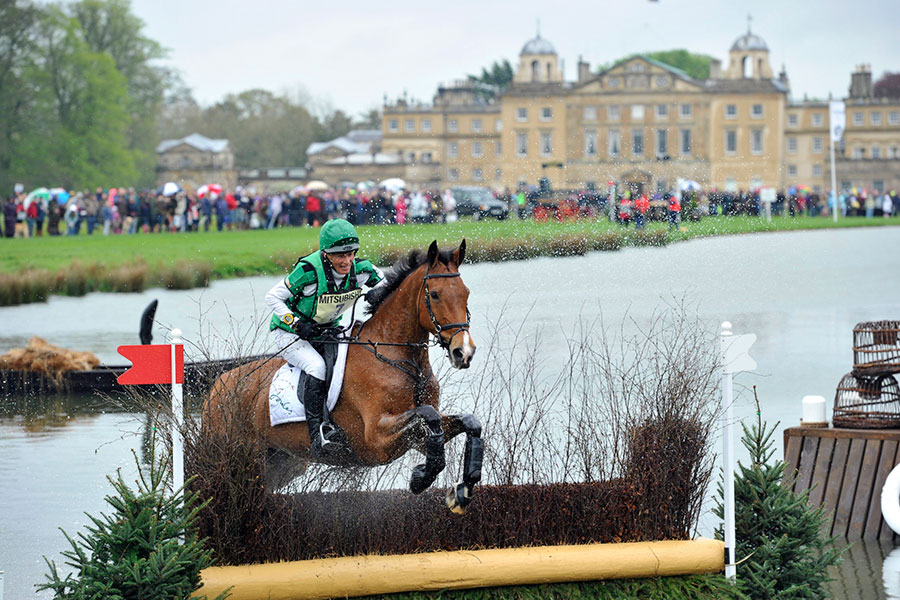 An image of a horse clearing a fence at Badminton Horse Trials - book a chauffeur to this event from GandT Executive