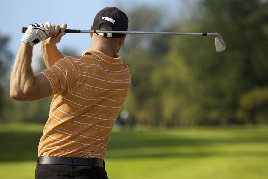 An image of a golfer competing in the British open golf championchip - book a chauffeur to this event from GandT Executive