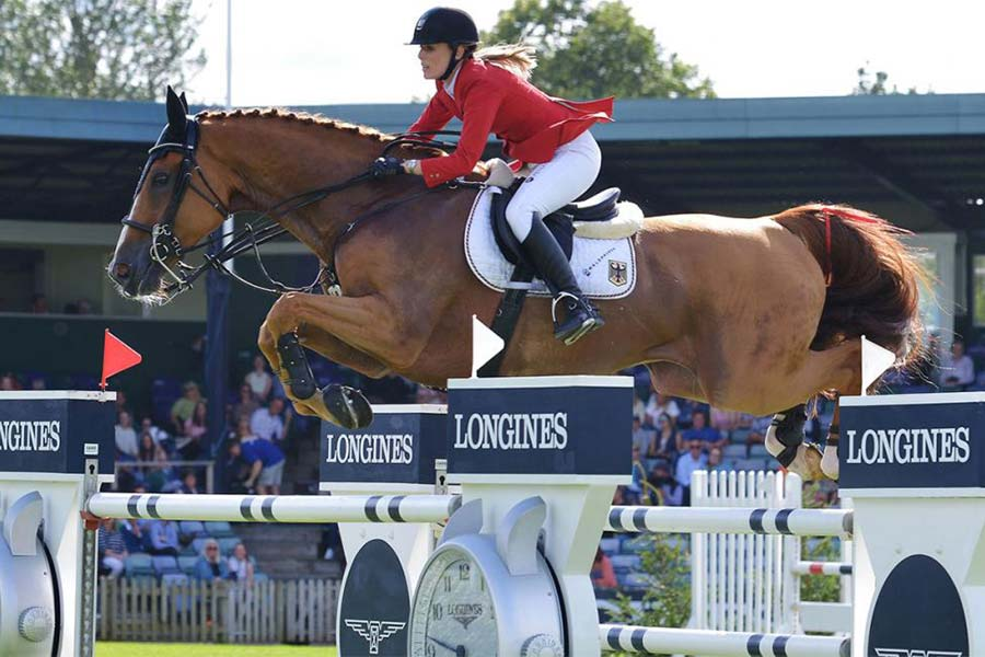 An image of a horse rider competing in the Longines Royal International Horse Show Hickstead - book a chauffeur to this event from GandT Executive